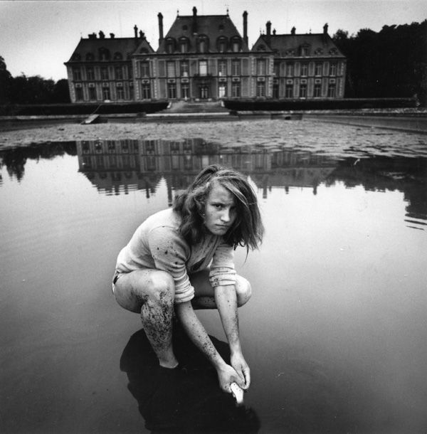 Girl Collecting Gold Fish, France