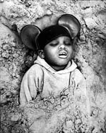 Arthur Tress - Boy in Mickey Mouse Hat, Coney Island, NY Click for more Images